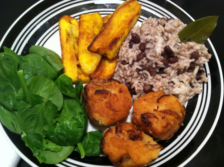 Fried dumplings and plantains with coconut rice.